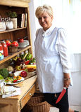 Senior woman preparing fruit salad Stock Images