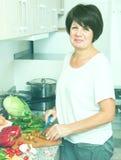 Senior woman preparing salad Stock Photo