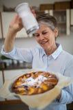 Senior woman preparing sweet food Stock Image