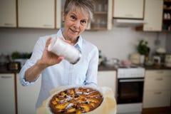 Senior woman preparing sweet food Royalty Free Stock Image
