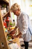 Senior woman preparing vegetables Stock Photo