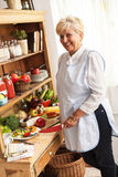 Senior woman preparing vegetables Royalty Free Stock Photos
