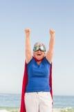 Senior woman pretending to be a superhero Royalty Free Stock Photos