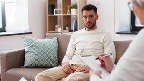 Senior woman psychologist and sad man patient stock video