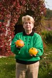 Senior woman with pumpkins Royalty Free Stock Photography
