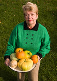 Senior woman with pumpkins Royalty Free Stock Images