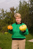 Senior woman with pumpkins Stock Image