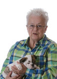 Senior woman and puppy Royalty Free Stock Photos