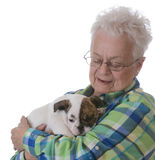 Senior woman and puppy Royalty Free Stock Photo