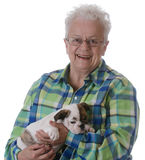 Senior woman and puppy Stock Photo