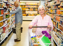Senior woman pushing trolley Stock Images