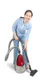 Senior Woman Pushing Vacuum Cleaner Stock Photography