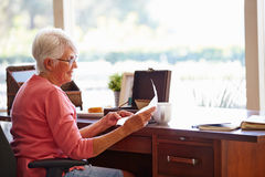 Senior Woman Putting Letter Into Keepsake Box Royalty Free Stock Photo