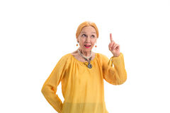 Senior woman with raised finger. Stock Image