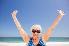 Senior woman raising her arms Royalty Free Stock Image