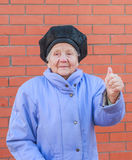 Senior woman raising thumb up. Photo took in Moscow, Russian Stock Photos