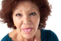 Senior woman razz cheerful isolated on white stock image