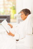 Senior woman reading Royalty Free Stock Photos