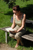 Senior woman reading Royalty Free Stock Image