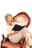Senior woman reading. Stock Image