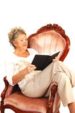 Senior woman reading. Royalty Free Stock Image