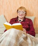 Senior woman reading book Stock Photo