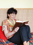 Senior woman reading book Stock Photos