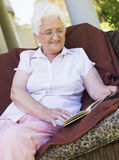 Senior woman reading book Royalty Free Stock Photo