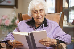 Senior woman reading book. Portrait Of Senior woman reading book Royalty Free Stock Images
