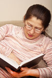 Senior woman reading a book Stock Photos