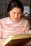 Senior woman reading a book Stock Image