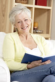 Senior Woman Reading Book At Home Royalty Free Stock Photo