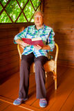 Senior woman reading a book Royalty Free Stock Image
