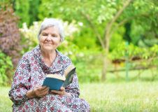 Senior woman reading book. Stock Photography