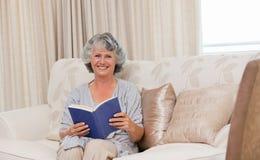 Senior woman reading her book Stock Photos