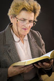 Senior woman reading holly bible Stock Photos