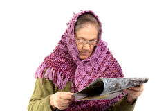 Senior woman reading magazine Royalty Free Stock Images
