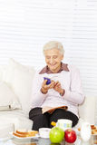 Senior woman reading message on her Stock Images