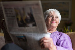 Senior woman reading morning newspaper Royalty Free Stock Photos