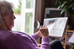 Senior woman reading morning newspaper Stock Photos