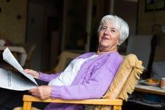 Senior woman reading morning newspaper Royalty Free Stock Photos
