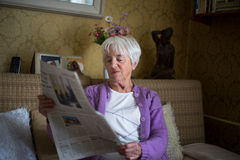 Senior woman reading morning newspaper Royalty Free Stock Images