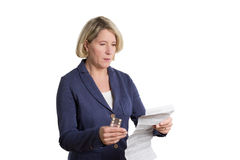 Senior woman reading package insert. Of her new medication, copy space, isolated Royalty Free Stock Image