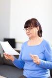 Senior woman reading something on paper Royalty Free Stock Photo