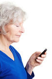 Senior woman reading text message Royalty Free Stock Photo