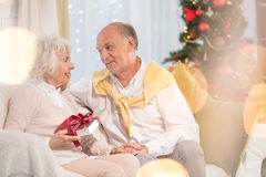 Senior woman receiving Christmas gift Stock Photo