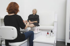 Senior Woman Receiving Foot Massage In Hair Salon Royalty Free Stock Images