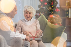 Senior woman receiving gift from husband Royalty Free Stock Photos
