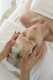 Senior Woman Receiving Head Massage Royalty Free Stock Photos