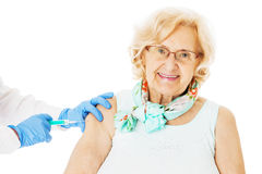 Senior Woman Receiving Injection From Doctor Stock Photography